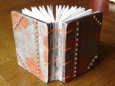 faux riveted and rusted metal (polymer clay) and coptic bound blank book