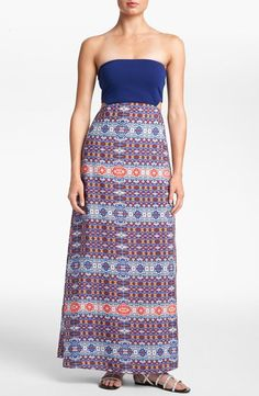 On trend: a gorgeous maxi dress with cutouts.