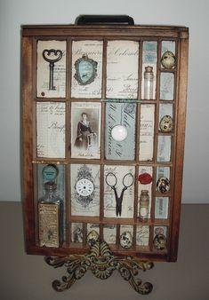 Vintage items displayed in printers' tray by viola