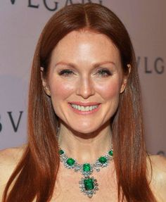 Julianne Moore wears one of Elizabeth Taylors Bulgari pieces, a necklace in platinum with 16 octagonal step-cut Colombian emeralds (total weight 60.5ct) and diamonds, circa 1962.