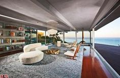 Moneyball star Brad Pitt had sold his bluff-top Malibu home to talk show host Ellen DeGeneres for $12,000,000.