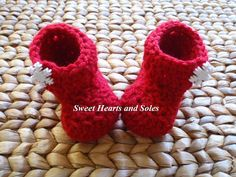 Red snowflake handmade crochet baby boots keep little toes toasty warm!    Please stop by my Etsy shop at www.etsy.com/shop/sweetheartsandsoles for more baby booties, as well as baby & toddler accessories!
