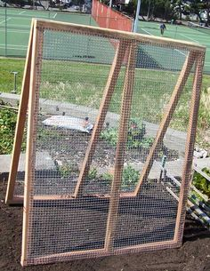 A-Frame Trellis: two cedar 2×2 frames, hooked together with hinges. The blogger, suggests using chicken wire, rather than the hardware cloth she used here, because the larger holes in the chicken wire would allow the cucumbers to dangle off the trellis. She has used this frame in her garden for 6 seasons.  {thank you, Jamie Pearce, for the pin}