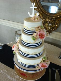 nautical theme wedding cake, blue and white wedding cake, anchors, fresh flowers on wedding cake, buttercream wedding cake,