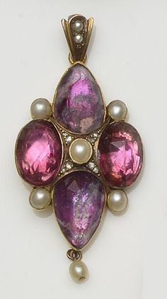 A 19th century quartz pendant Of quatrefoil design, set with four faceted quartz stones in closed-back setting, with half pearl and rose-cut diamond highlights, on later suspensory loop. [Assume early 19th century, looks more Georgian than Victorian in style and make.]