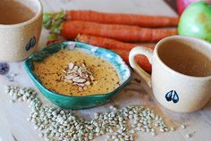 Spiced up carrot and lentils soup, with toasted almonds on top