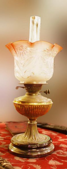 An intact antique oil lamp. photographed at the Willis Museum, Basingstoke.