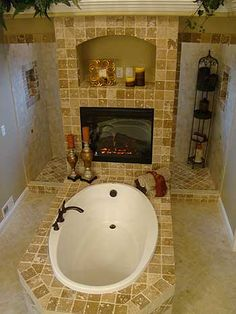 How awesome! Whirlpool tub in center of room with fireplace and shower behind!