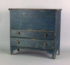 "New England painted pine mule chest, late 18th c., retaining an old blue surface, 42 1/2"" h., 42 1/4"" w."