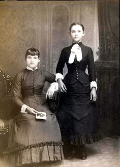In this photo, the woman standing is the one who is dead.