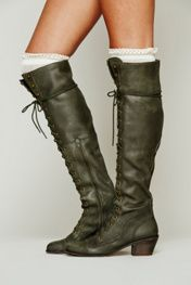 $298.00 Leather over-the-knee lace-up boots. Metal eyelet detailing. Short zipper on the inner sides. Stacked wood heel. Jeffrey Campbell for Free People Special Note: The grey color way featured in the November catalog is actually the light brown color way.