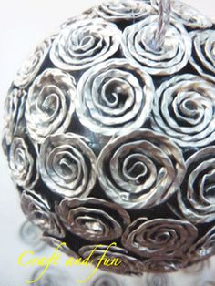 Tutorial Christmas ball covered with coffee capsules recycled .  Italian site but has lots of pics