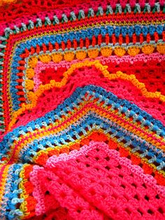 Love the colors and variety of stitches used for the edging.