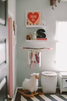 Sienna's Graphic Girly Nursery Nursery Tour | Apartment Therapy baby girl rooms, soft pink, nursery decor, branch, babies nursery, nurseri, babies clothes, kid room, painted sticks