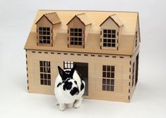 Cape Cod style wooden playhouse for rabbits