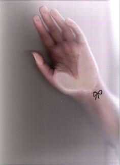 cute small bow tattoo.