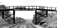A car crosses the Old Marley Road bridge which spanned the Rock Island Railroad. Since it was a single lane bridge, a driver honked, hesitated, and then honked again before proceeding across the bridge.
