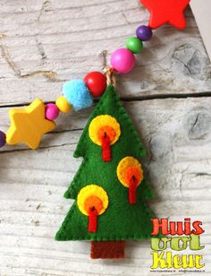 felt christmas tree ornament decorated with candles