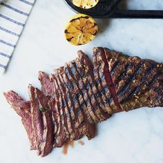 Lemon-and-Garlic-Marinated Flat Iron Steak | The flat iron steak, which sits on the shoulder blade next to the teres major, is great for marinating and grilling.
