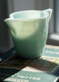 Vintage Pale Green Milk Glass Like Creamer. $9.50, via Etsy.