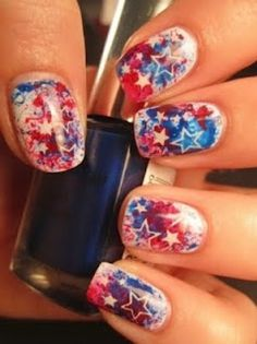 Pinterest/Beautytipsntricks.com shows us how to make splatter nails stand out with a white star nail sticker.