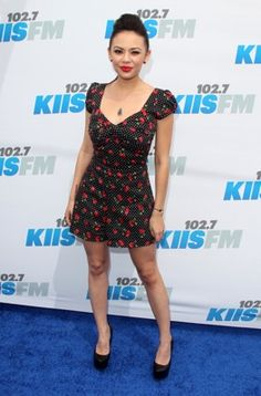 Janel Parrish in a sweet cherry dress