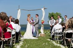 Outdoor waterfront ceremony at Rowleys Bay Resort. Door County wedding by http://www.JMannPhoto.com 920-246-8106