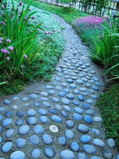 Chart a New Path  It's easy to create a walkway from your driveway or sidewalk to your front door. Use a garden hose as a guide for placement. Here, the curved path adds visual interest. Set brick or rocks alongside the hose. Use a yardstick to place the rocks for the other side of the path exactly 3 feet away, then fill the path with gravel or wood chips