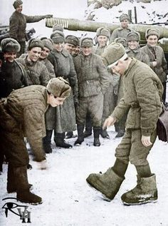 .A Soviet soldier shows off his new snow boots.