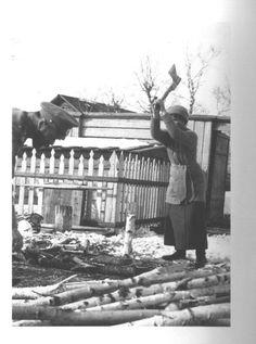 Olga chopping wood in Tobolsk, 1917.