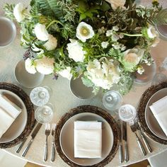 Round wedding reception tables adorned with our Natural Woven Chargers + Heath Ceramics in French Grey + Pewter Flatware + Vintage Cut Crystal Glassware set atop an ecru linen. // Casa de Perrin