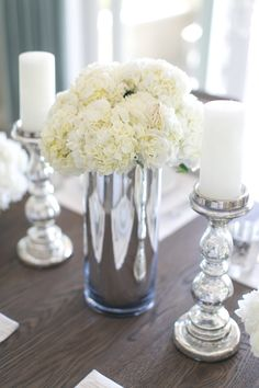 #silver, #centerpiece, #sparkle, #metallic, #candle  Photography: Bryce Covey - brycecoveyphotography.com  Read More: http://www.stylemepretty.com/living/2014/01/09/charlotte-hales-home-tour/