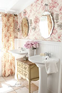 FRENCH COUNTRY COTTAGE: Lovely antique dresser in between the sinks and the wallpaper with matching curtain.
