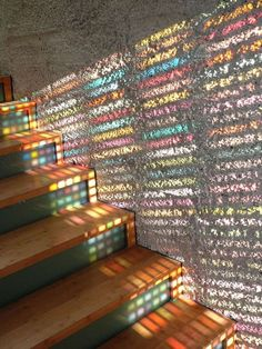 sunlight shining through  Armin Blasbichler's Inception Pantone Glass door glass doors, architects, stair, window, colors, color charts, light, design, stained glass