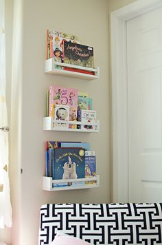 modern navy, coral, and gold bedroom; toddler girls room, modern toddler bedroom, Ikea spice rack book shelves, ikea bookshelf hack, ikea spice rack hack