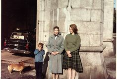 Naughty: The Queen and Princess Margaret relax against a wall in the sunshine, perhaps una...
