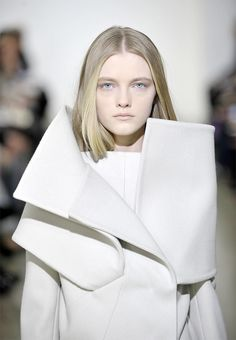 Sculptural folds. I believe this is a Calvin Klein coat from 2008. I have this same picture cut out from a magzine somewhere. :)