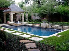 Swimming pool with water feature and gazebo