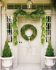 Moss wreath, garland, topiaries :: makes me want to paint my door white!