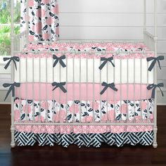 Navy and Coral Ruffles Crib Bedding   Carousel Designs.  A frillier version of our Coral and Navy Floral collection, this crib bedding is a stand-out. Featuring our triple tier ruffled skirt and ruffled crib bumper in contemporary shades of navy blue and coral pink this is truly a must have for your little girls nursery.