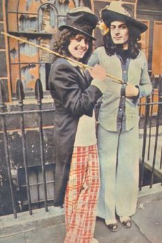 Marc Bolan and Mick Ronson stepping out.