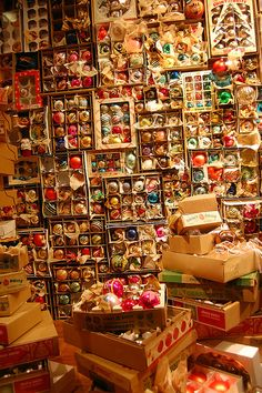 a wall of vintage ornaments.