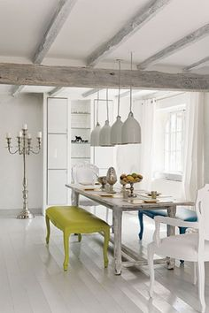 A very white cottage (with flashes of color).  Lesson...rustic can be white.  [CasaGiardino]