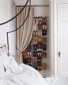 This may work for me. Keeps the shoes spread out so I can see them, and the curtain conceals them when I'm not searching for shoes!