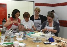 The team from M's World came by for a team building cake decorating class!