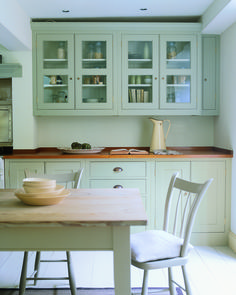 A great way to update a tired looking kitchen is to give your cupboards a fresh coat of paint! These units are painted in French Gray Estate Eggshel ball kitchen, kitchen cupboards, paint