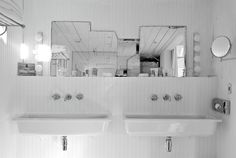 The mirrors, the his-n-hers utility sinks, the white-on-white action... yes yes yes.