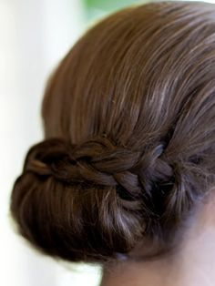 Braid over tucked-up hair. I'm thinking if I do a braid on each side, roll up the middle section and pin the two braids over and under this could work...