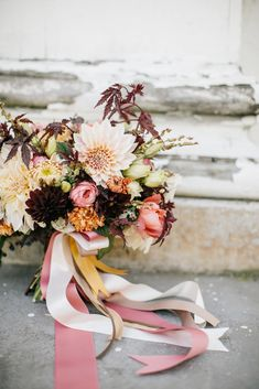 romantic fall bouquet featuring dahlias and chocolate cosmos
