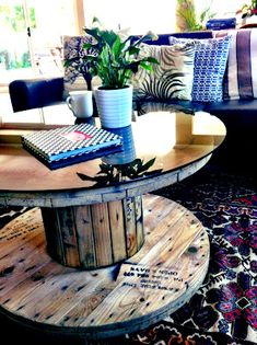 Add a piece of glass to make an upscale coffee table from an electrical cable spool. #cablespool #wire spool #diy